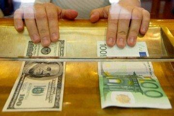 Goldman euro/dolar tahminini düşürdü