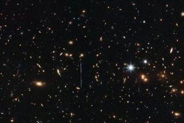 Hubble, 3 katrilyon Güneş kütlesinde galaksi kümesini görüntüledi