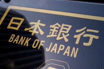 BOJ enflasyon tahminini düşürdü